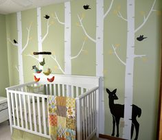 Wall decals & crib we want. Soft green walls, pops of yellow. Love all of it.