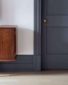 These plinth blocks are the perfect example of how to transition from large baseboards to door trim beautifully.