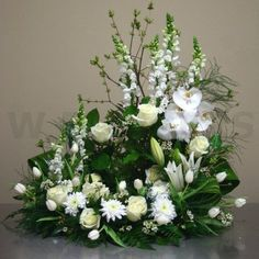 This wreath comes in many sizes and the colors may be changed as well. This piece is perfect for memorial services where either an urn or photo may be placed inside. This is a very loving a classic tr