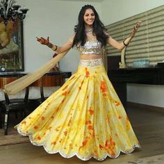 """@akankshagajria on Instagram: """"My super sweet client Avantika looking like a doll at her Mehendi ceremony in a sunflower yellow tie dye with orange bursts box pleated lehenga & a mirror encrusted choli  #TheRIOTSQUAD #THERIOTSWIRL #SunflowerYellow #TheHappyBride #TheRiotBride #AkankshaGajriaLabel⭐️"""""""