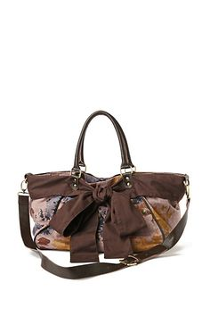 Anthro bag with interesting strapping, good shape, and nice bow detail