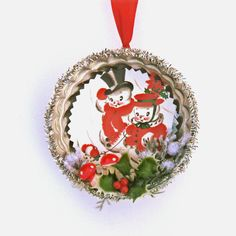 Vintage inspired Christmas Ornament with cute snow people. Vintage aluminum jello mold re-styled into a fun Christmas decoration. A cute 1950s snow