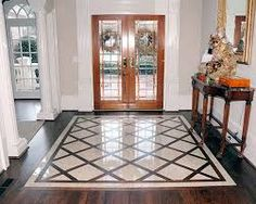 The idea of the tile inset in the wood in our back entry way.  Not this design, but the idea of keeping the wood feel integrated through out and not completely using title.  tile entryways and foyers - Google Search