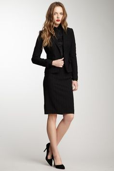 Dolce and Gabbana pinstripe skirt suit.