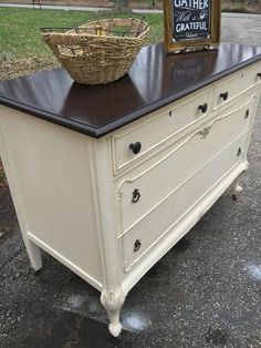 """Once Upon A Window stained the top of this stylish dresser with General Finishes Java Gel Stain and then sealed it with High Performance Top Coat satin. Vintage Farmhouse Paints """"Antique Lace"""" was painted on the base before aging with Miss Mustard Seeds clear and dark wax, and then a final coat of Polyvine Wax Finish Varnish in 'dead flat' was added to seal."""