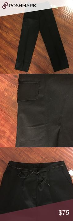 Versailles Black Cargo Style Pants These are made by Versailles New York and are not cheap, and these are new with the tags still attached. They feature both and inside button and zipper in the front along with a wonderful tie all around the waist that lets you also adjust them if your waist is smaller. There's side open pockets at the top on each side along with a Velcro closed large pocket on the outside of right leg in addition to a back Velcro closed pocket on back right hip. Inseam is…