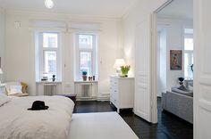 Bedroom - white walls & furniture, wood floor