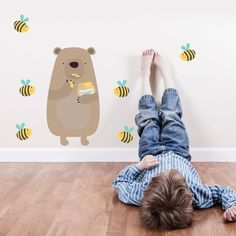 Honey thief bear is surrounded by bees and looking adorable. Created as Fabric Wall Stickers these great illustrations will create a fun feature.Please feel free to browse our range of vinyl wall stickers and newly listed fabric wall stickers. You can also contact us to ask us any questions.....  Honestly anything! Our fabric wall stickers are fun and easy to apply. Simply peel and stick! Perfect decor idea for children's nursery, playroom or bedroom. Kids can even get involved too, they…