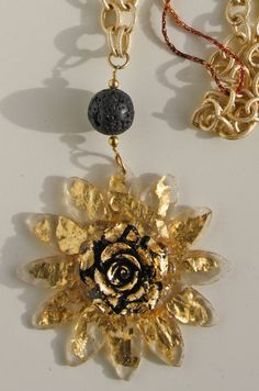3D-pendant necklace, with transparent resin and gold color bronze metal foil insertions, gold plated Alu-chain necklace.
