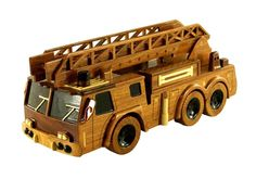 Ladder Truck - Premium Wood Designs #Military #Car #Truck #Wood premiumwooddesigns.com Wooden Toy Trucks, Wooden Car, Woodworking Workshop, Woodworking Projects, Dad Crafts, Easy Wood Projects, Firetruck, Wooden Gifts, Wood Toys