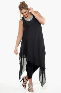Wow!  This stunning chiffon tunic top (or short dress if you dare) has a dramatic asymmetrical hemline.  It also features a diamante cluster at the neckline.