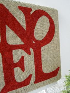 Stenciled words on a burlap canvas ! I would do each letter on a separate canvas tho to make a bigger piece