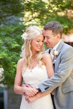 Brides: Classic Half-Up Hair with White Flower. Photo:  Rebecca Gosselin Photography