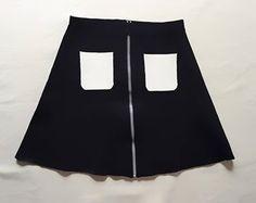 """Mini-jupe SANDRO bleu vendu par le dépôt vente de Luxe, Mode, Art et Design...""""luxExclusive"""" Paris"""