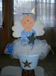 Resultado de imagen para centro de mesa para bautizo con globos de niño