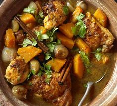 Moroccan chicken tagine with butternut squash and lots of apricots...and olives, coriander... and honey.