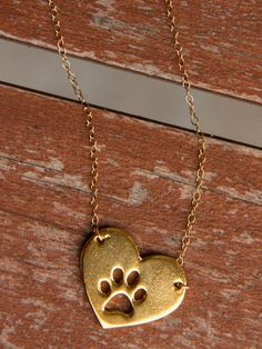 gold heart paw necklace <3