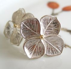 Exquisite texture in these delicate little hydrangea earrings...