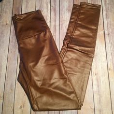 NWT gold brown faux leather leggings Thin and stretchy faux leather leggings! Large waist band to ride high waist 26-30 inches with stretch Pants Leggings