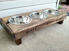 3 stainless steel dog bowl stands made from reclaimed pallet wood.