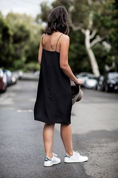 Wearing: Ginia slip dress, Adidas Stan Smith sneakers and Akubra The slip dress can definitely be dressed up, but it's even better dressed down. Worn with simple sandals or sneakers, it quickly gives Long Slip Dress, Black Slip Dress, Black Dress Outfits, Outfit 2017, Black Women Fashion, Womens Fashion, Fashion Tag, Minimal Outfit, Dress With Sneakers