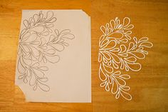 Puffy paint after it has dried and been removed from the pattern that was drawn on wax paper.