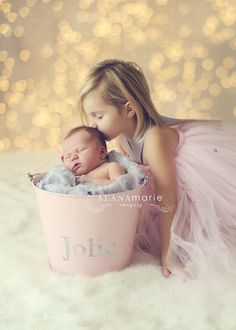 newborn sibling portrait newborn baby girl in pink bucket with big sister in tutu dress. adorable!!! © Alana Marie Imagery www.alanamarieimagery.com www.facebook.com/AlanaMarieImagery