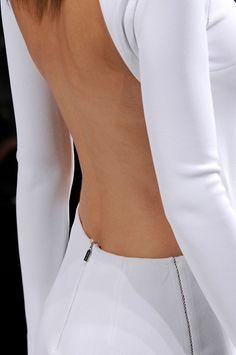 White open back long sleeved dress.