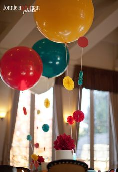 3 foot balloons with paper decor attached, great way to fill high spaces!