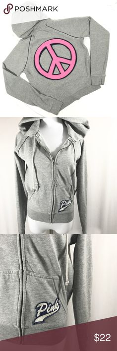 "VS Pink Grey Peace Sign Zip Up Hoodie Victoria's Secret Pink Grey Peace Sign Zip Up Hoodie Sweatshirt. Size Medium. 60% cotton, 40% polyester. Length measures from the back of the neck is 23"". Bust measures 20"". There is some piling on the peace sign. Otherwise in excellent preowned condition. No trades, offers welcome. PINK Victoria's Secret Tops Sweatshirts & Hoodies"