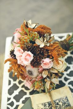 rustic wedding bouquet with pinecone accents. #myweddingTheMagazine