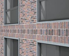 Horizontal bands of vertical brickwork are articulated with set-back bricks to exaggerate shadows.