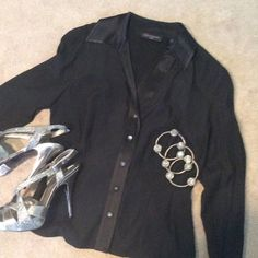 Fancy black satin blouse 95% satin.  Somewhat tapered at the waist. Lace tie design in the back. Tops Blouses