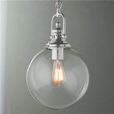 "Clear Glass Globe Industrial Pendant Clear Glass Globe Industrial Pendant (16""Hx10""W) 60 watts. (medium base socket) 6' chain, 8' wire. (no extra wire available) 5"" canopy. Product SKU: PE11020 PN Price:  $129.00"