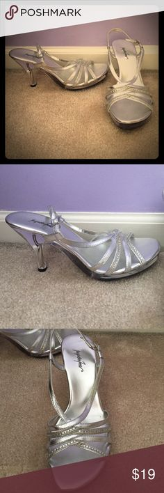 """Silver strappy heels Gorgeous silver heels with rhinestone straps, heel and bottom are clear to look like glass heels 😍 very comfy. 3.5"""" heel. New, never worn, other than to try on. Jacqueline Ferrar Shoes Heels"""