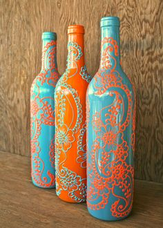 Set of 3 Hand Painted Wine bottle Vases, Turquoise and Coral Orange, Vibrant Henna style design via Etsy Wine Bottle Vases, Old Wine Bottles, Painted Wine Bottles, Diy Bottle, Wine Bottle Crafts, Bottles And Jars, Decorated Bottles, Decorative Glass Bottles, Beer Bottle