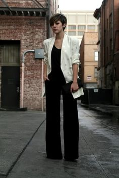 white structure blazer with silver polka dots. Black jumpsuit or top with…