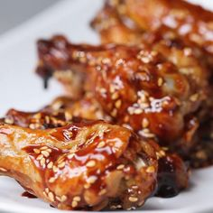 Featuring Honey BBQ Chicken Wings, Slow Cooker Root Beer Chicken Wings, Nashville-Style Hot Wings, Honey Garlic Chicken Wings, Spicy Mango Chicken Wings and Teriyaki Baked Wings Honey Bbq Chicken Wings, Baked Chicken Wings, Oven Baked Chicken, Butter Chicken, Garlic Butter, Sesame Chicken Wings Recipe, Baked Garlic, Chipotle Chicken, Chicken Dips