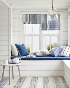 Buys to Embrace the Coastal Interiors Trend A bright and airy window seat in a beach house living room. Nautical never looked so good.A bright and airy window seat in a beach house living room. Nautical never looked so good. Coastal Bedrooms, Coastal Living Rooms, Coastal Homes, Coastal Decor, Home Living Room, Coastal Style, Coastal Cottage, Modern Coastal, Coastal Farmhouse