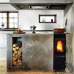 Tiny black wood stove. Source: itsfurnitureporn