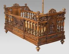 203: A. Dubois carved walnut infant bed with canopy : Lot 203