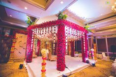 Red rose dominated square-shaped mandap decor A square canopy, the mandap looks gorgeous with rosesYou can find Wedding mandap and more on our website.Red rose dominated square-shaped mandap decor A square canopy, the mandap looks gorgeous with. Desi Wedding Decor, Wedding Hall Decorations, Marriage Decoration, Wedding Entrance, Wedding Mandap, Art Deco Wedding, Wedding Attire, Wedding Ideas, Arch Wedding