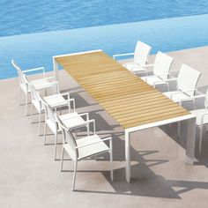 Bella Vita Outdoor Dining Table. The tactile teak slats, which comprise the tabletop, are crafted with precision and appointed on white, reverse bevel style, aluminium legs