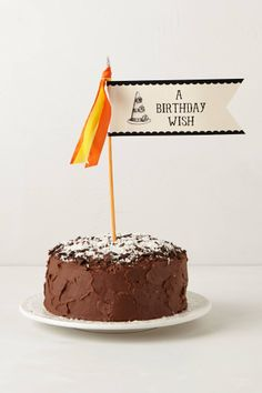 "Birthday cake flag! Could be for cupcakes too. ""To"" & ""From"" are on the back. 11.25""H x 6.25""W. (Decorative Party Pennants, set of 3 :: $10 @ anthropologie.com)"