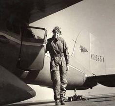 Amelia Earhart standing next to the open door of her Lockheed Vega plane, ca. 1935. George Palmer Putnam Collection of Amelia Earhart Papers, Courtesy of Purdue University Libraries, Karnes Archives and Special Collections.