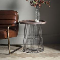 Menzies Side Table  The Menzies side table features a caged gun-metal frame and base with a weathered tray shaped timber top to give a casual look and style that perfectly fits the loft living look.