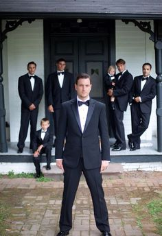 Dave in front groomsmen in the back with the ring bearers scattered around
