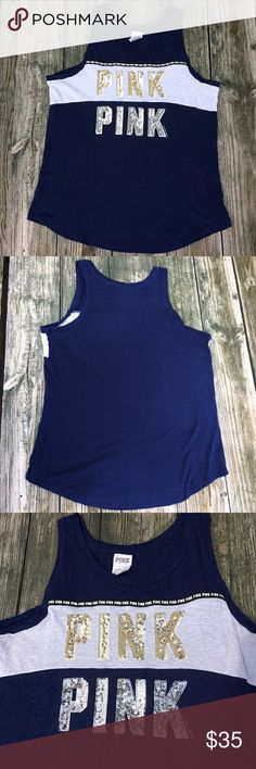 """Victoria's Secret PINK Sparkle Tank Victoria's Secret PINK solid navy blue tank top with sparkle """"PINK"""" decals in gold and silver. This item is in great condition and is a size large PINK Victoria's Secret Tops Tank Tops"""