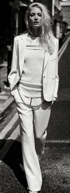 Melissa Tammerijn in an all white pantsuit