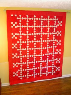 """Chained Melody"" This is one of a set of two quilts. The second one is called ""Unchained Melody"" and yet unfinished. It is the opposite color play. Both are fun with a traditional nine patch pattern."